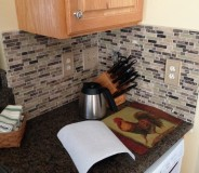 Custom Stone & Glass tile backsplash done by RMG