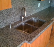 Custom granite counters with full height backsplash done by RMG
