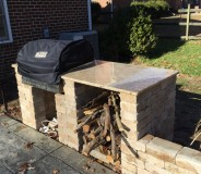 Custom granite outdoor grill surround done by RMG